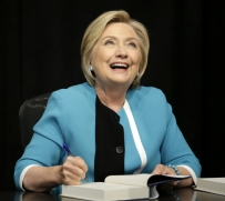 Hillary signing books